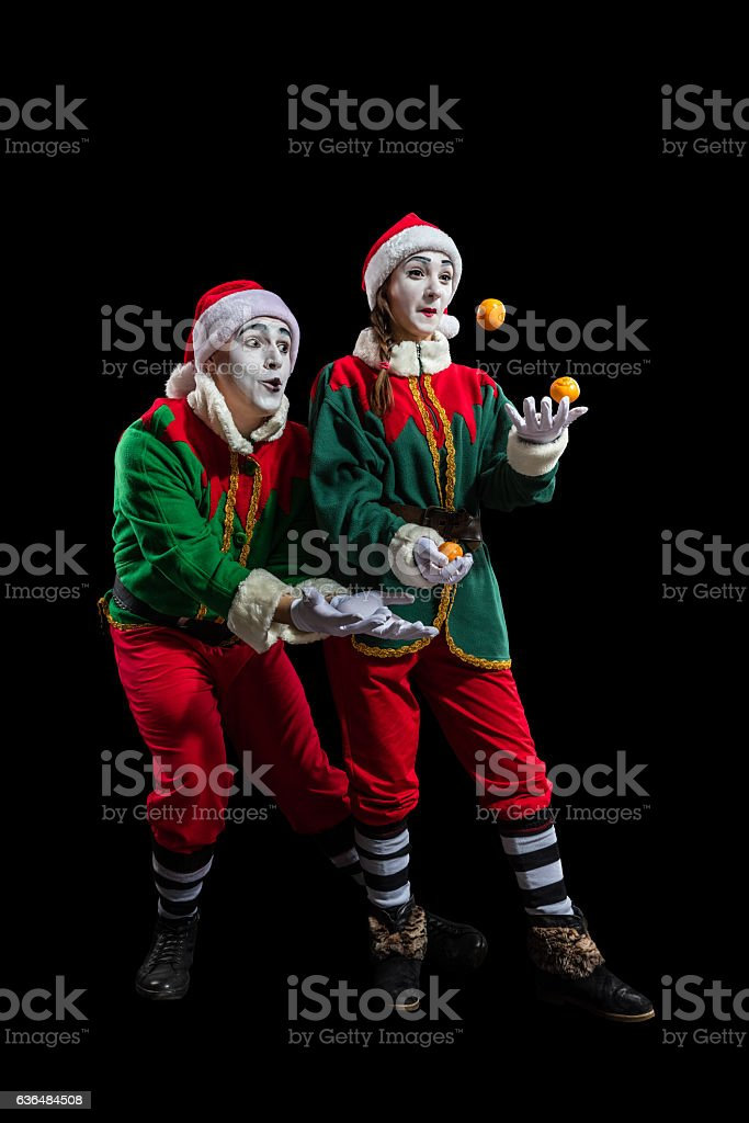Couple of mimes in New Year costumes isolated stock photo