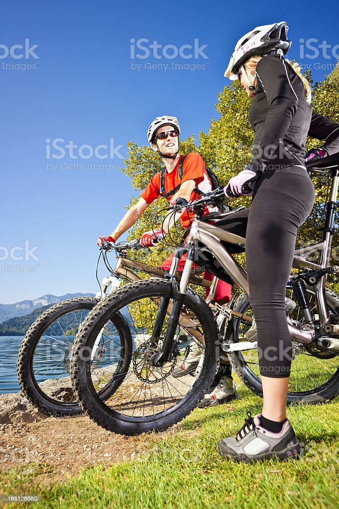 Couple of mountainbikers at Bled lake island royalty-free stock photo