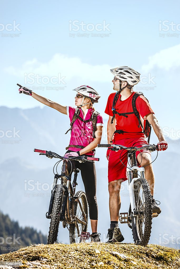 Couple of  mountainbikers on the top royalty-free stock photo