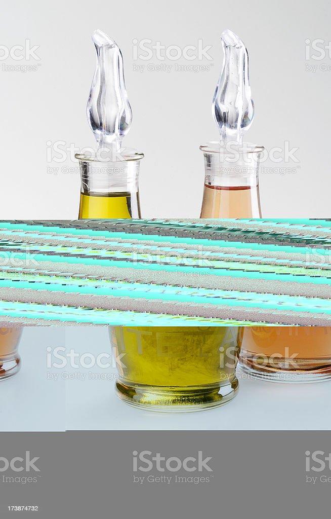Couple of olive oil and vinegar bottles stock photo