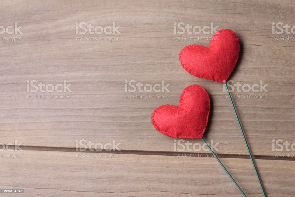 Couple of red Valentine's day heart shape decorations. stock photo