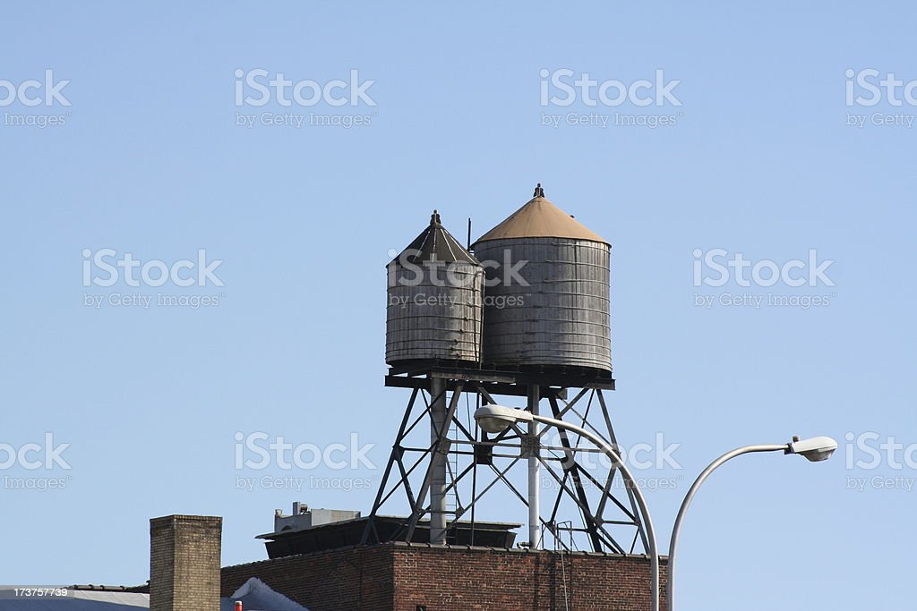 Couple of Rooftop Water Tanks royalty-free stock photo