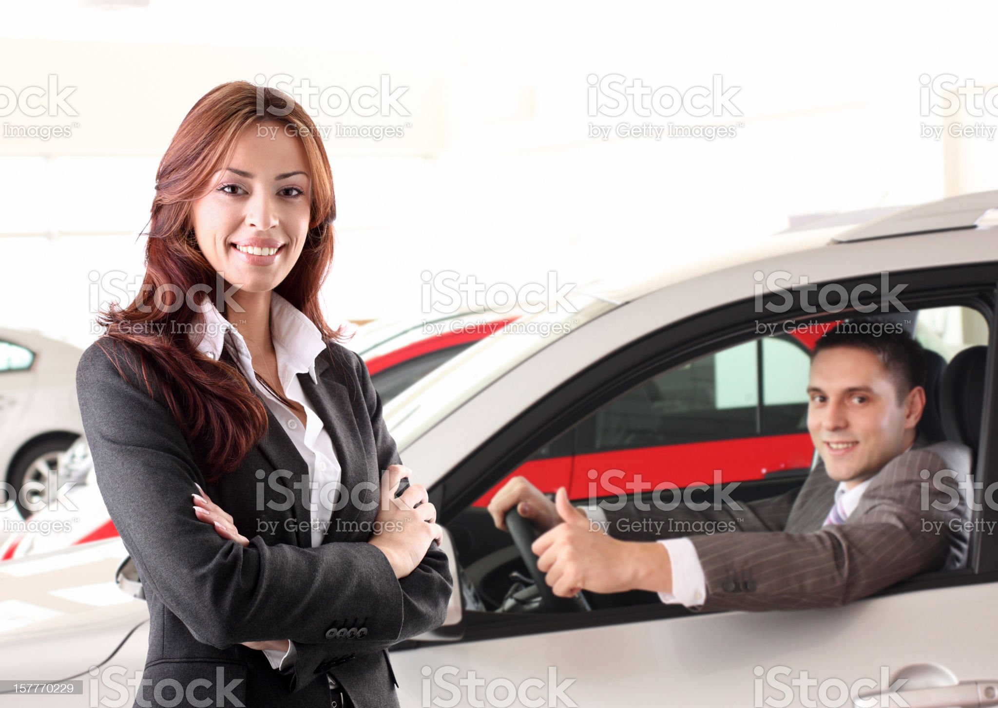 Couple of sales people at car dealership. royalty-free stock photo