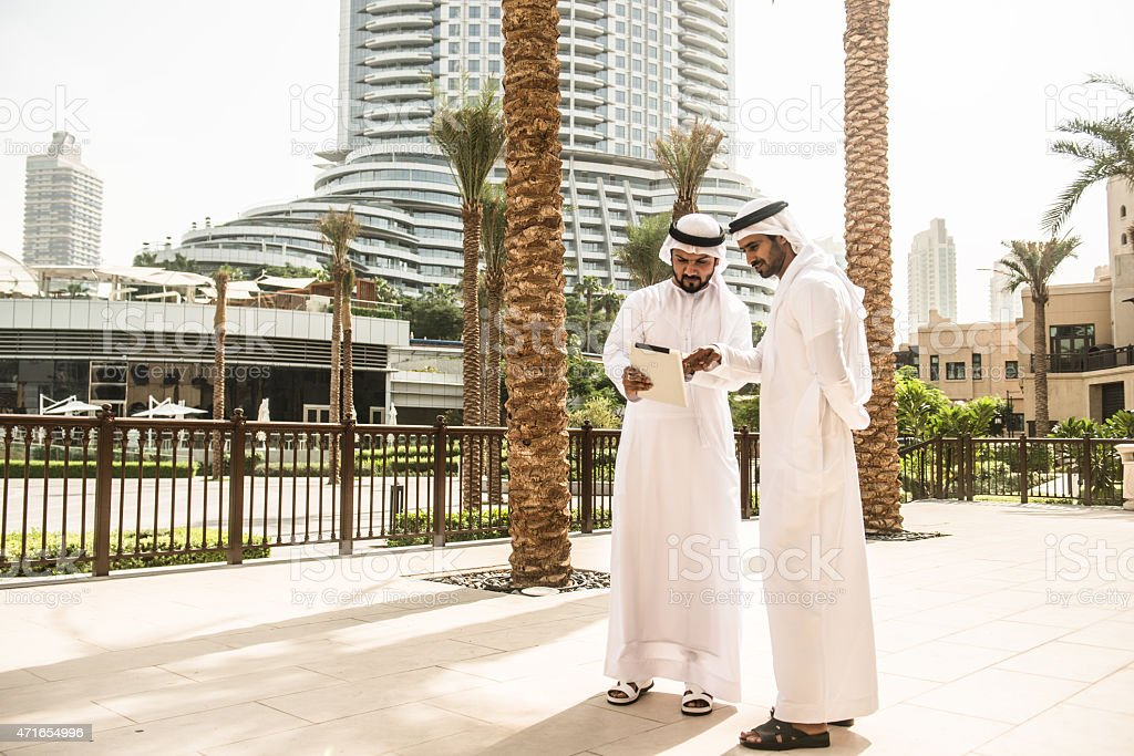 couple of sheikh friends surfing on the cit stock photo