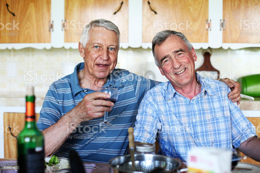 Couple of smiling male seniors at meal time royalty-free stock photo