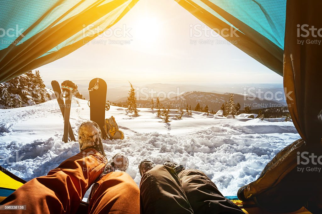 Couple of snowboarder and skier in tent stock photo