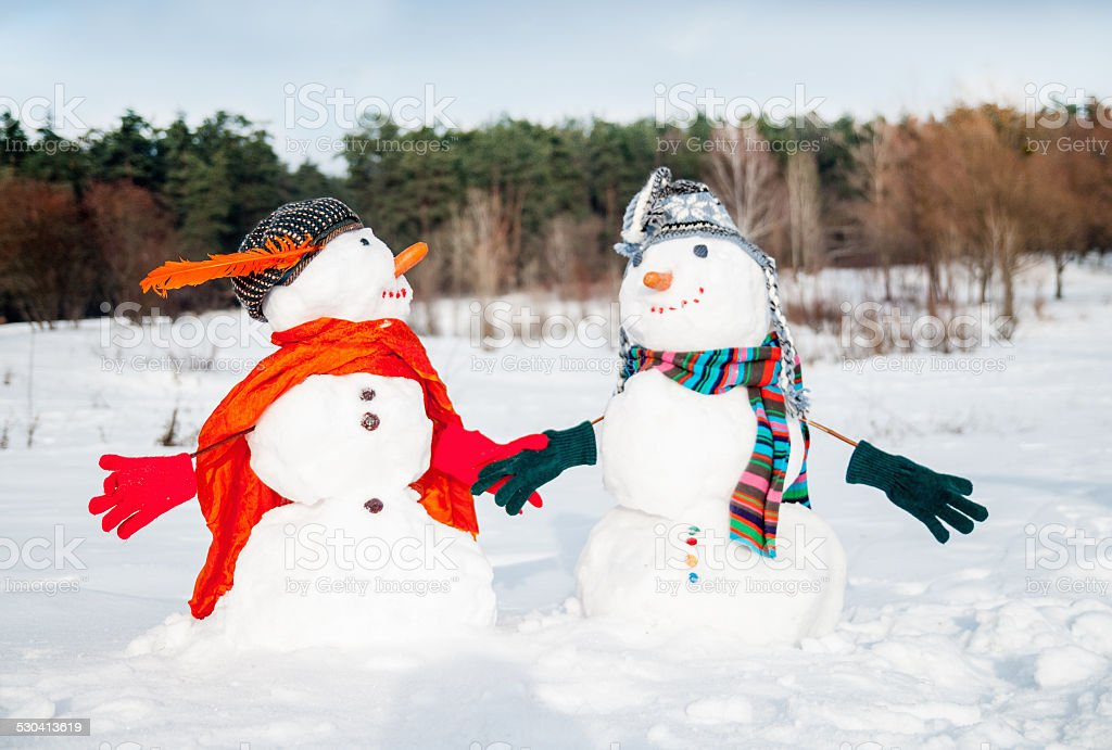 Couple of snowmen stock photo