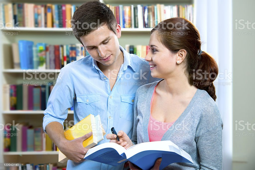 couple of students in a library royalty-free stock photo