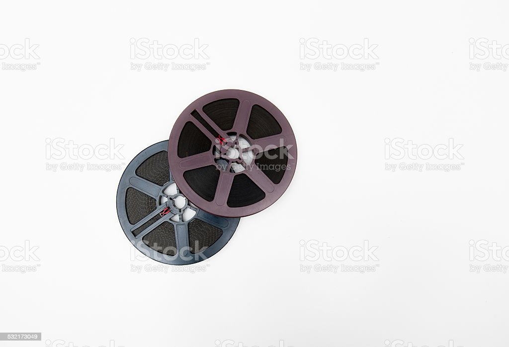 Couple of super 8mm reels grey and purple isolated stock photo
