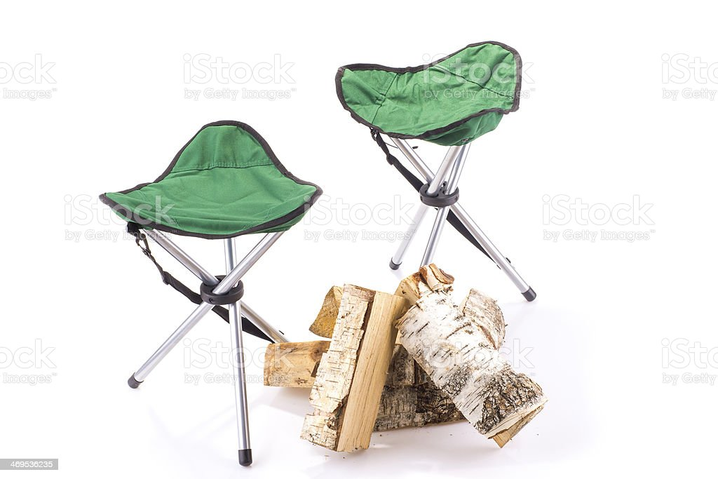 Couple of tourist chairs and firewood stock photo