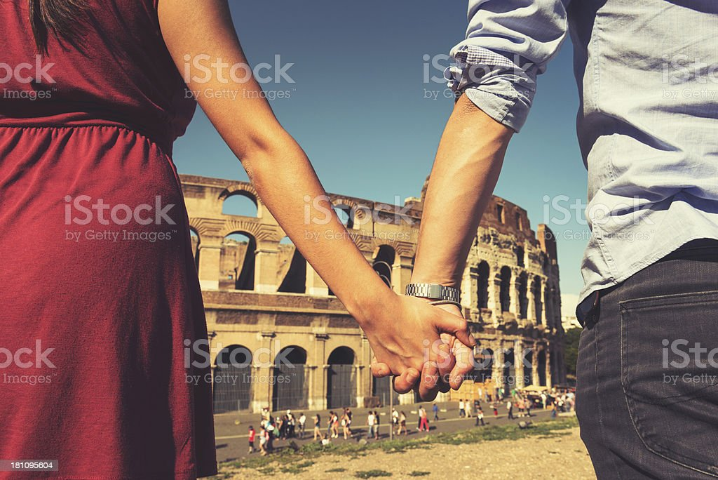 couple of tourist in front at coliseum stock photo