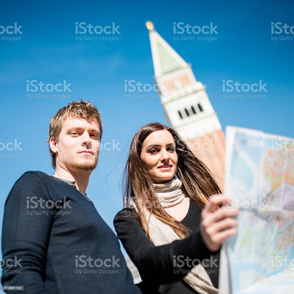 couple of tourist with map in Venice stock photo