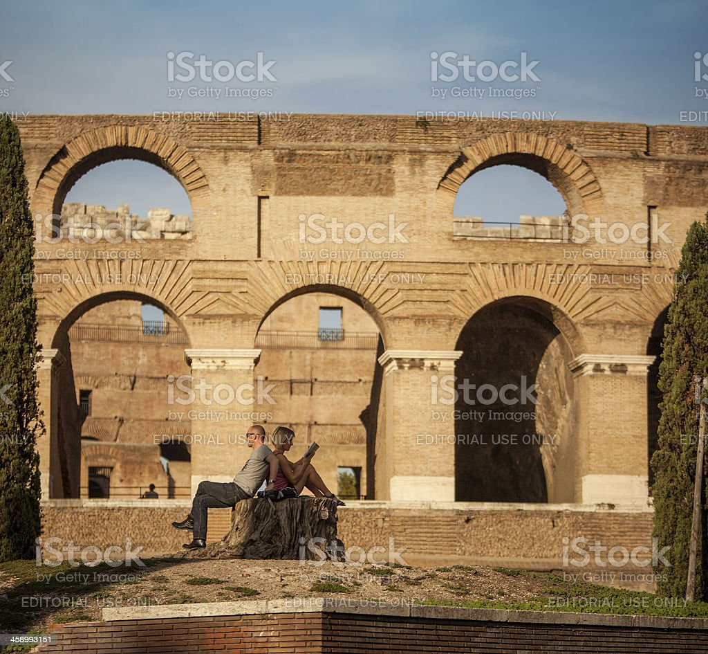 Couple of tourists at the Coliseum in Rome royalty-free stock photo