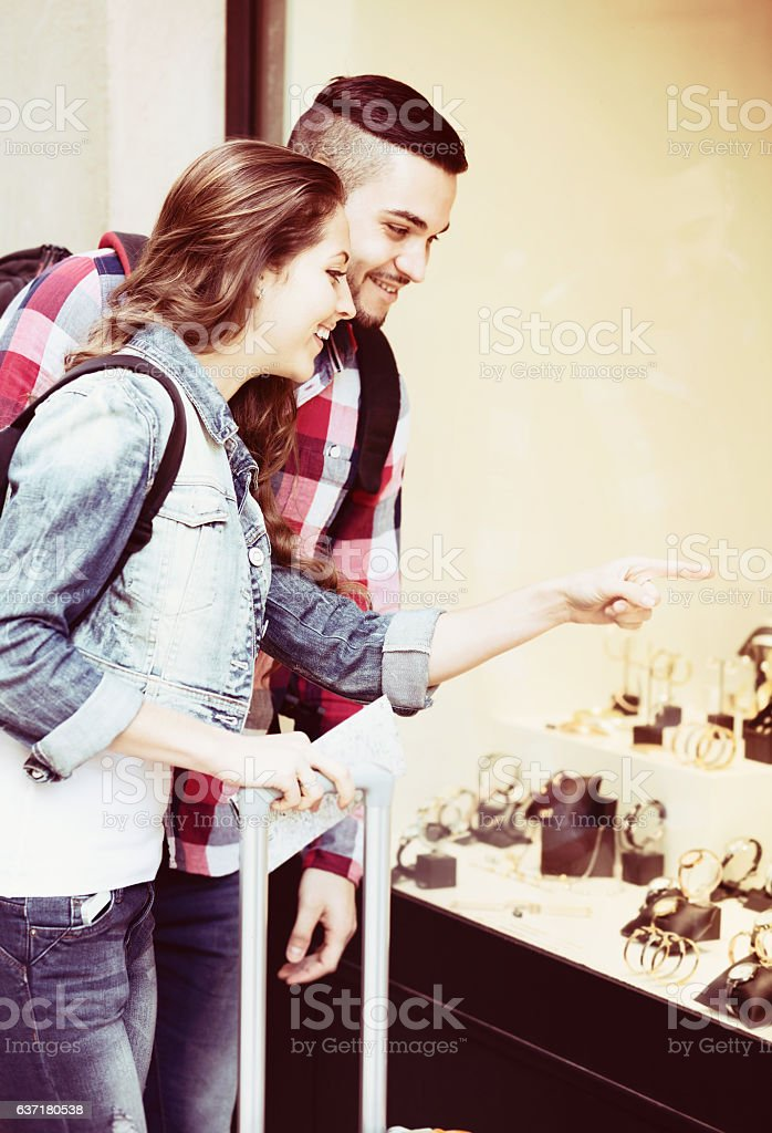 couple of tourists choosing wristwatch stock photo