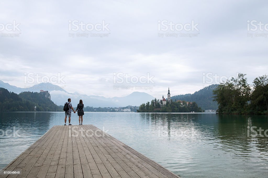 Couple of tourists in love on the Lake Bled, Slovenia. stock photo