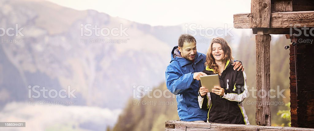 Couple of tourists in Switzerland using digital tablet stock photo
