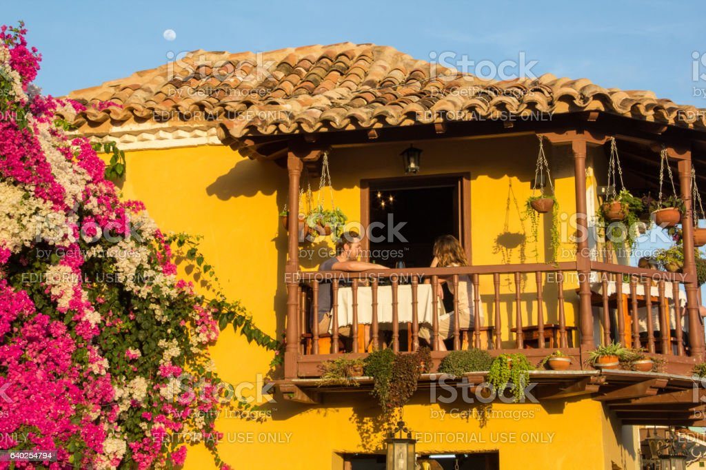 Couple of tourists on wooden balcony of restaurant , Trinidad stock photo