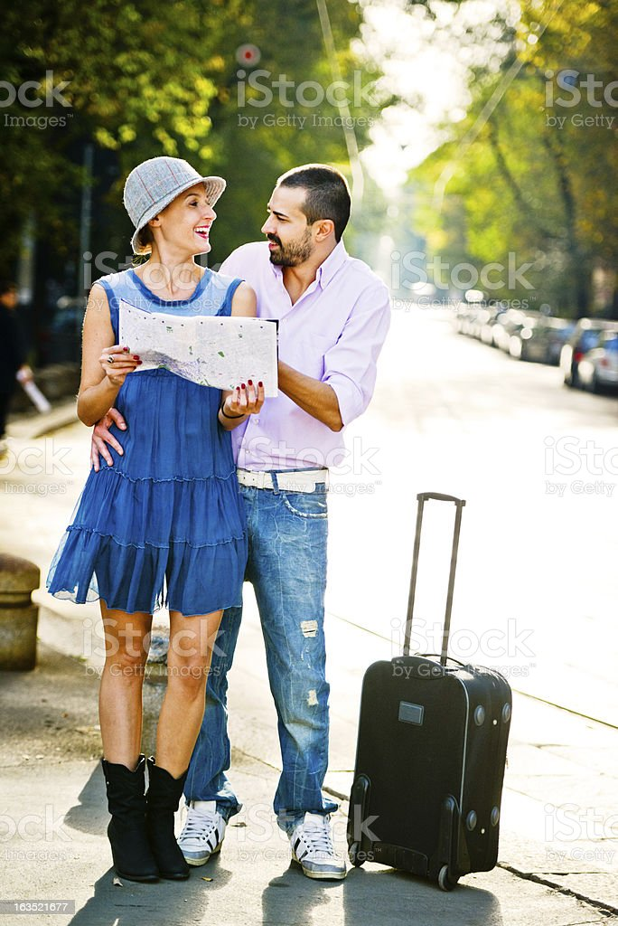 Couple of Tourists searching needed location on map in Milan stock photo