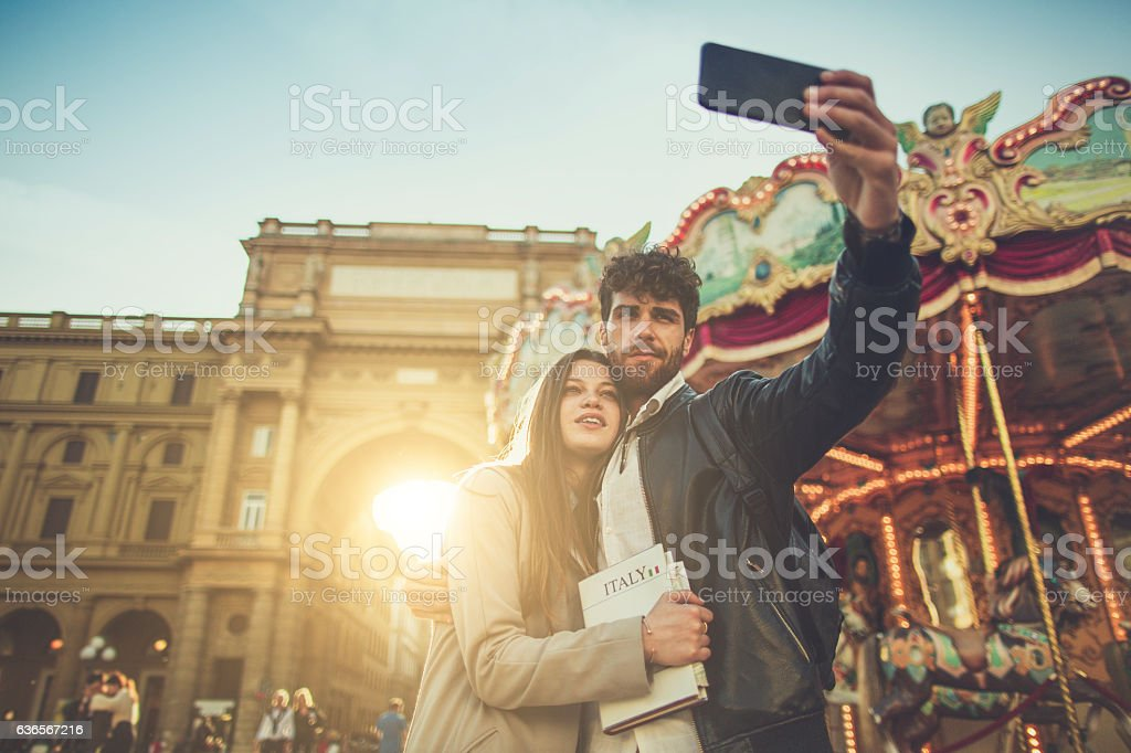 Couple of tourists take selfie in Florence, Italy stock photo