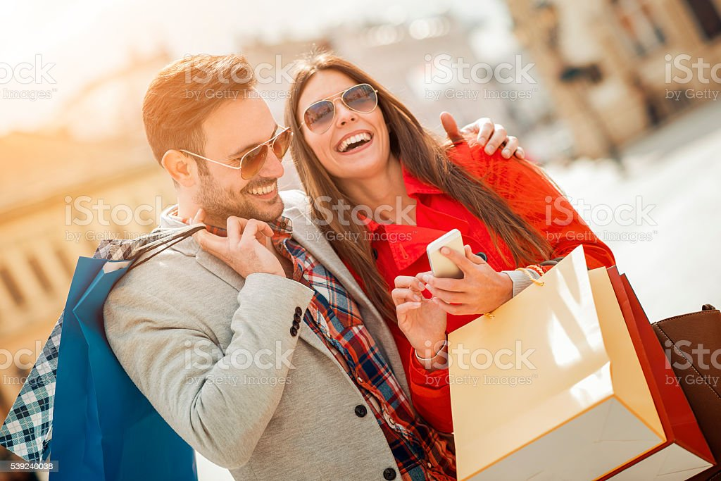 Couple of tourists walking in a city street stock photo