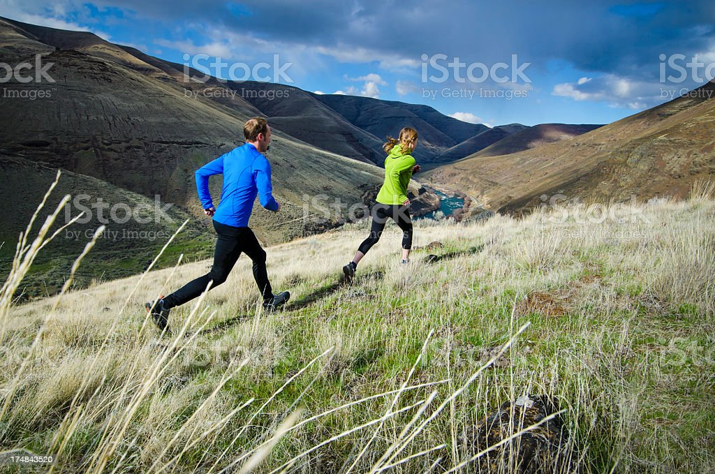 Couple of trail runners on a sunny day royalty-free stock photo