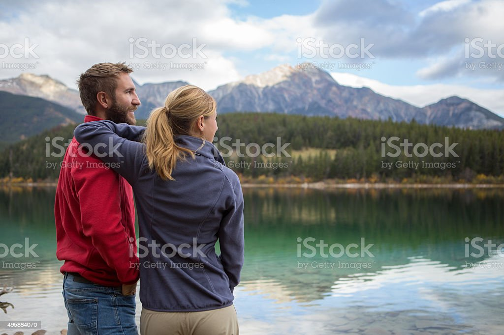 Couple of travelers contemplating the landscape stock photo