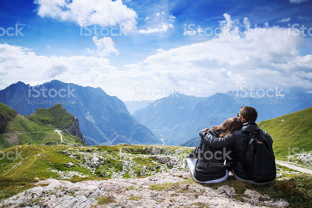 Couple of travelers (hikers) on top of a mountain. stock photo