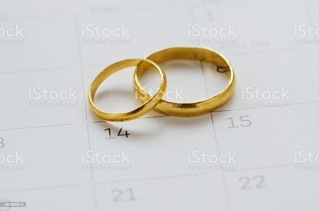 Couple of Wedding Rings on Calender stock photo