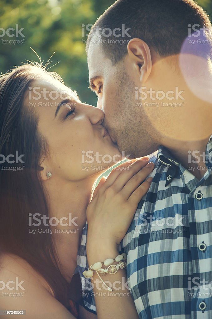 Couple of young lovers kissing royalty-free stock photo