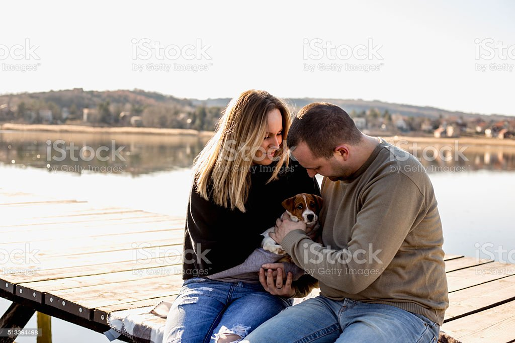 Couple of young lovers on the pier stock photo