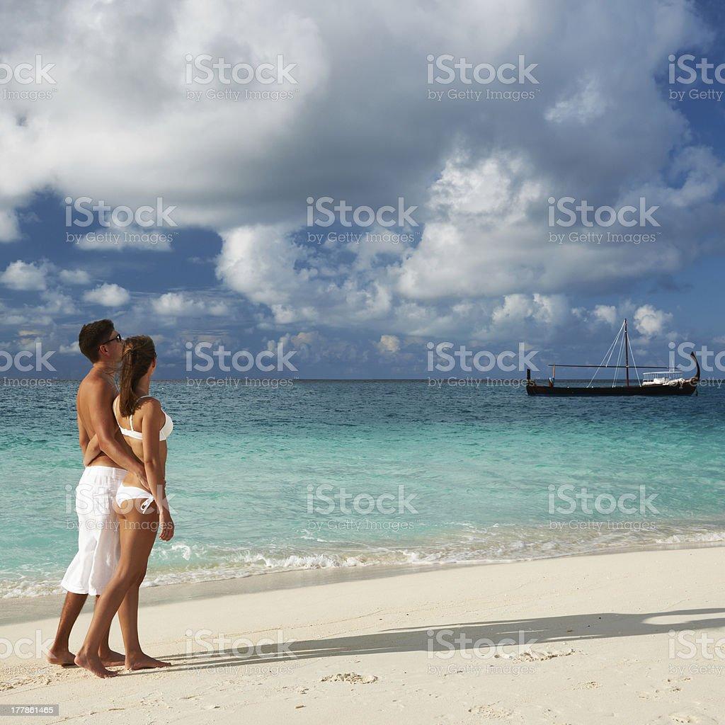Couple on a beach at Maldives royalty-free stock photo