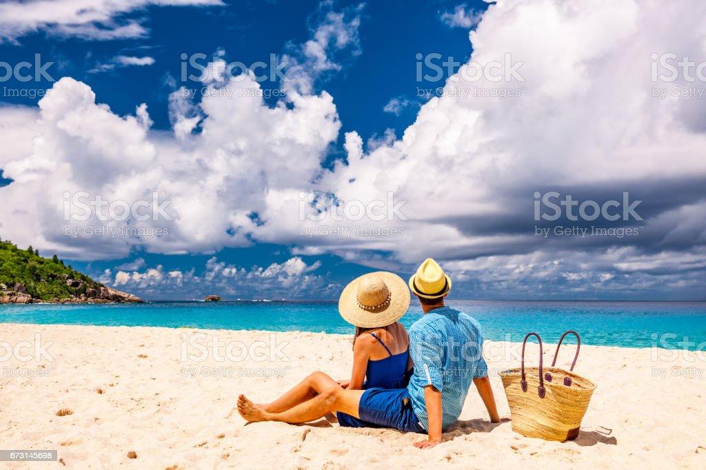 Couple on a beach at Seychelles stock photo