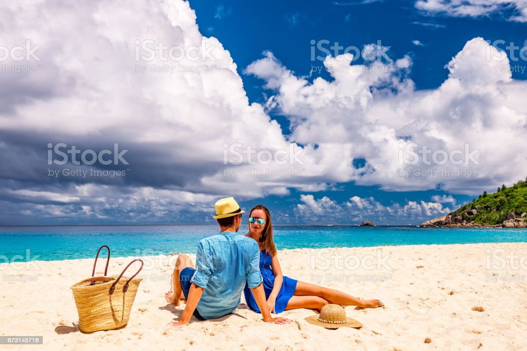 Couple on a beach at Seychelles stock photo