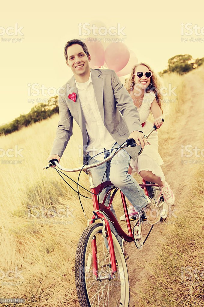 Couple on a Beach Cruiser stock photo