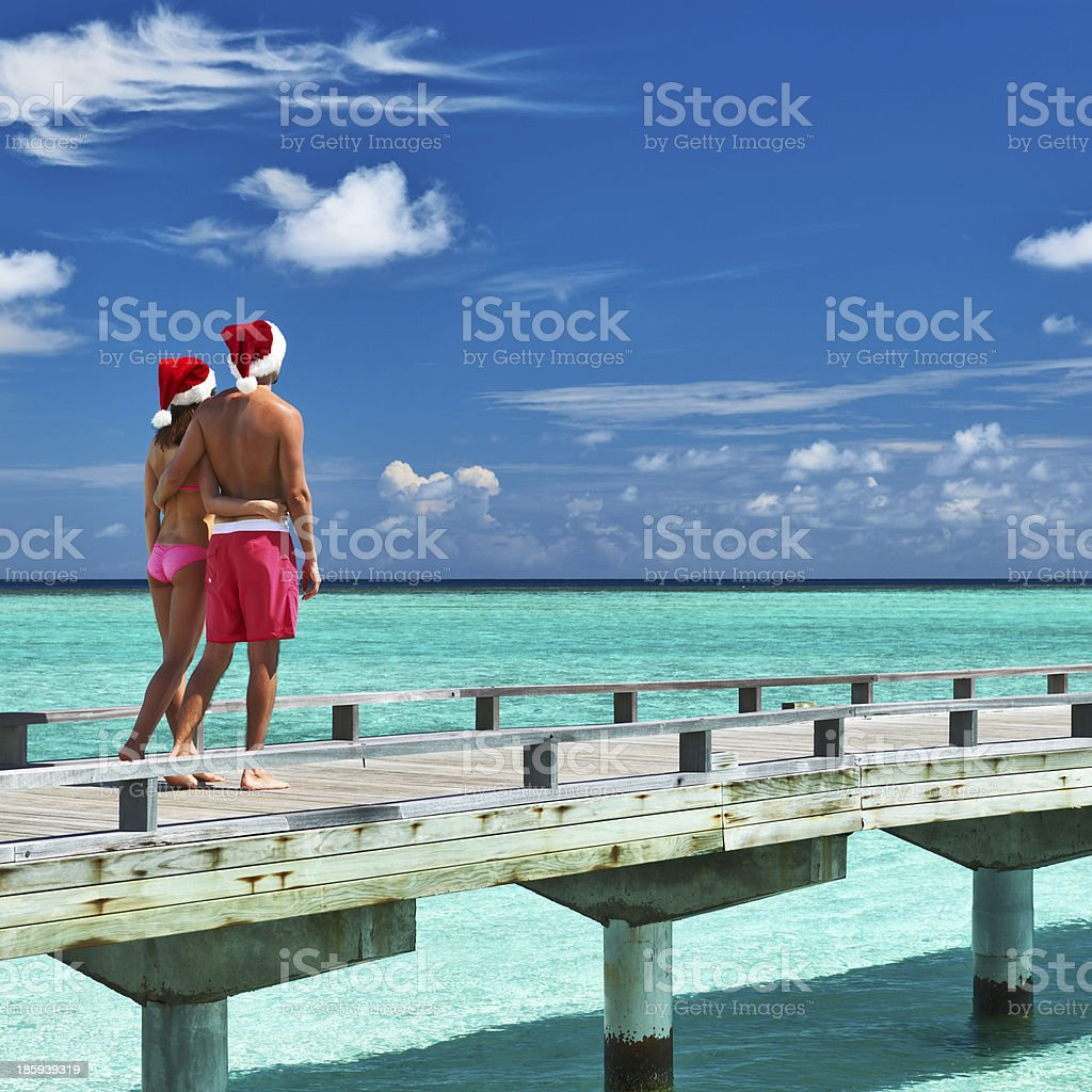 Couple on a beach jetty at Maldives royalty-free stock photo