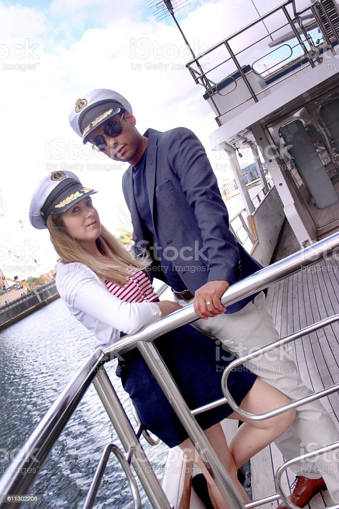 Couple on a boat dressed up stock photo