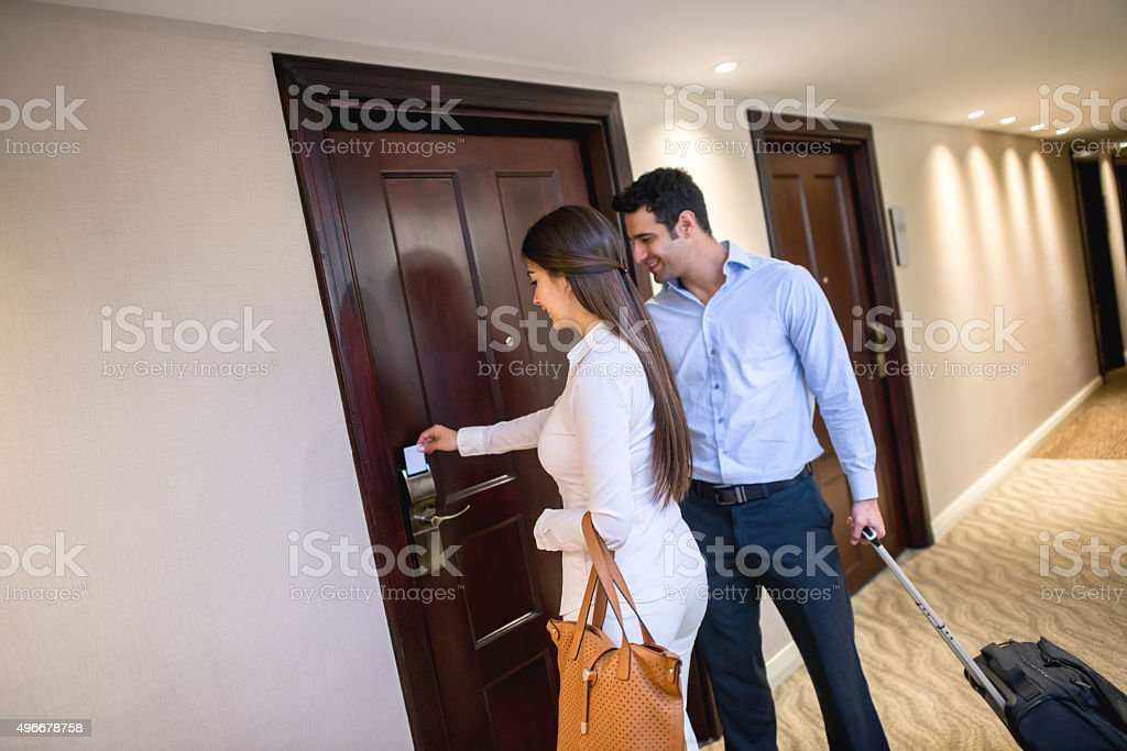 Couple on a business trip at the hotel stock photo