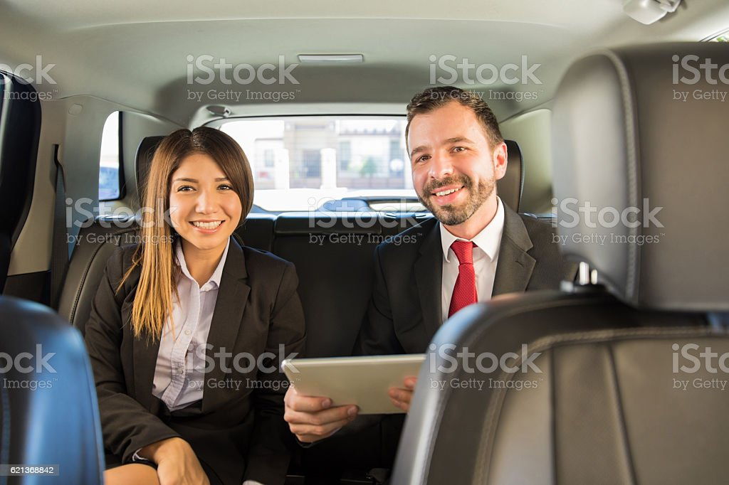 Couple on a business trip by car stock photo