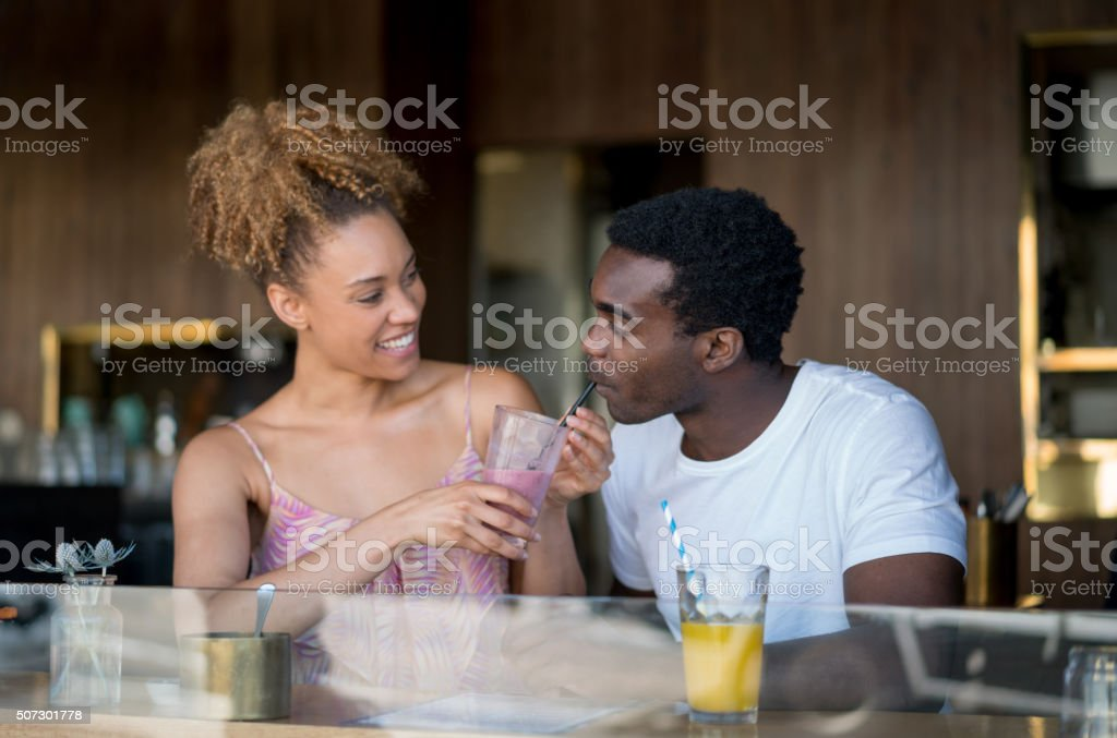 Couple on a date at a coffee house stock photo