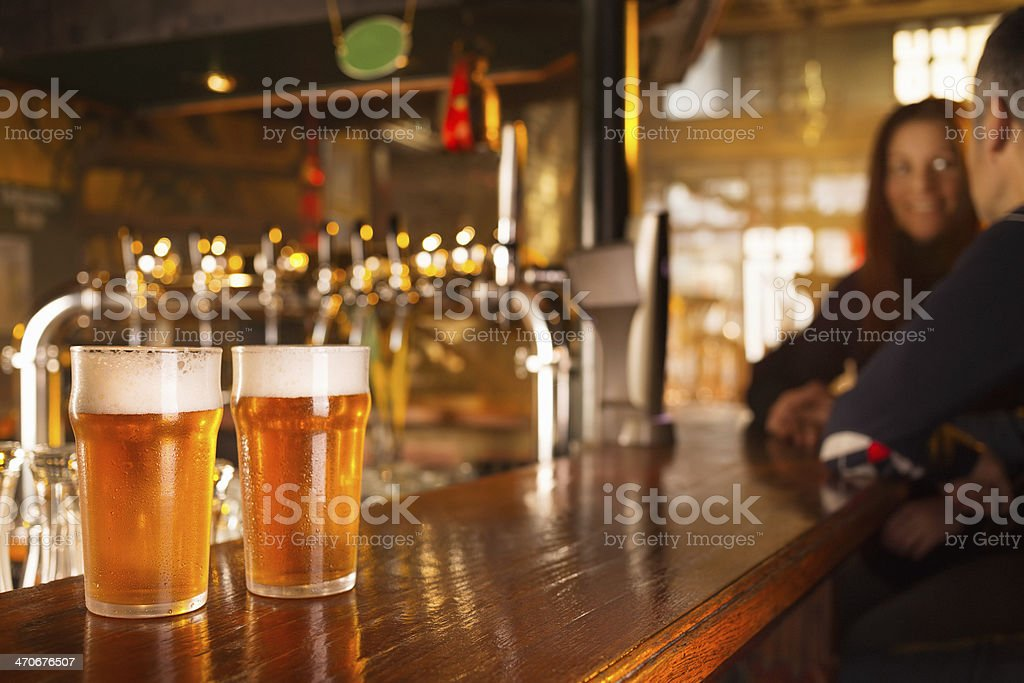 Couple on a date in pub stock photo