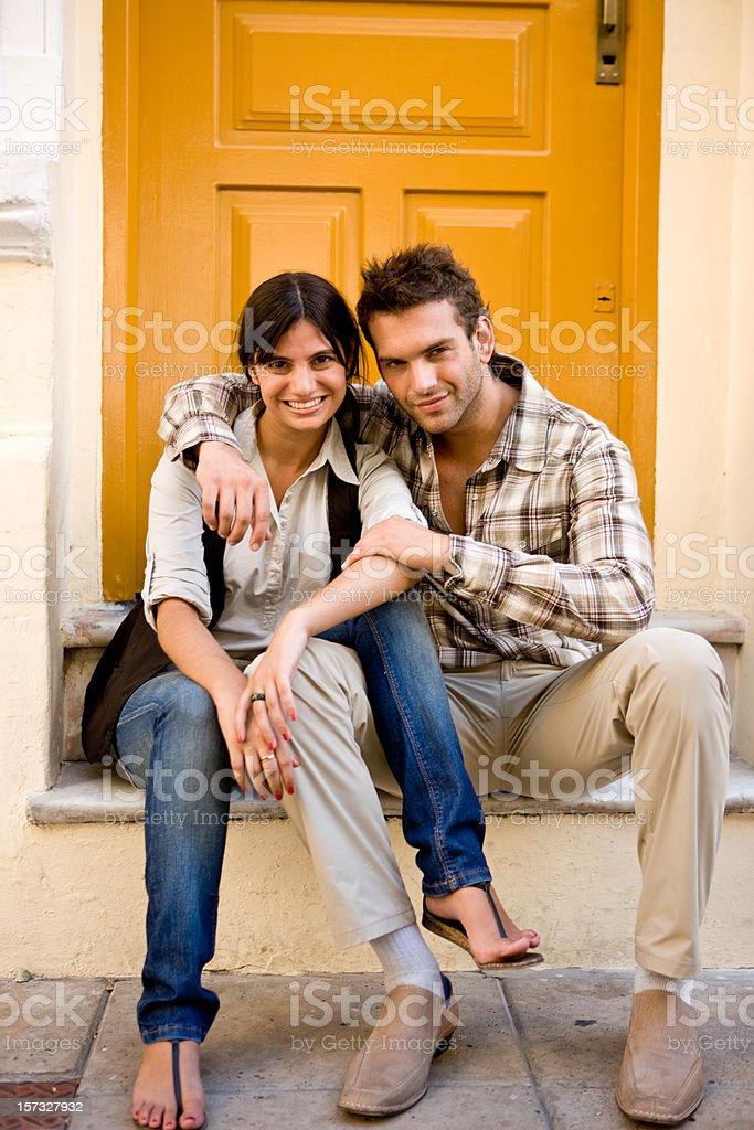 Couple on a doorstep royalty-free stock photo