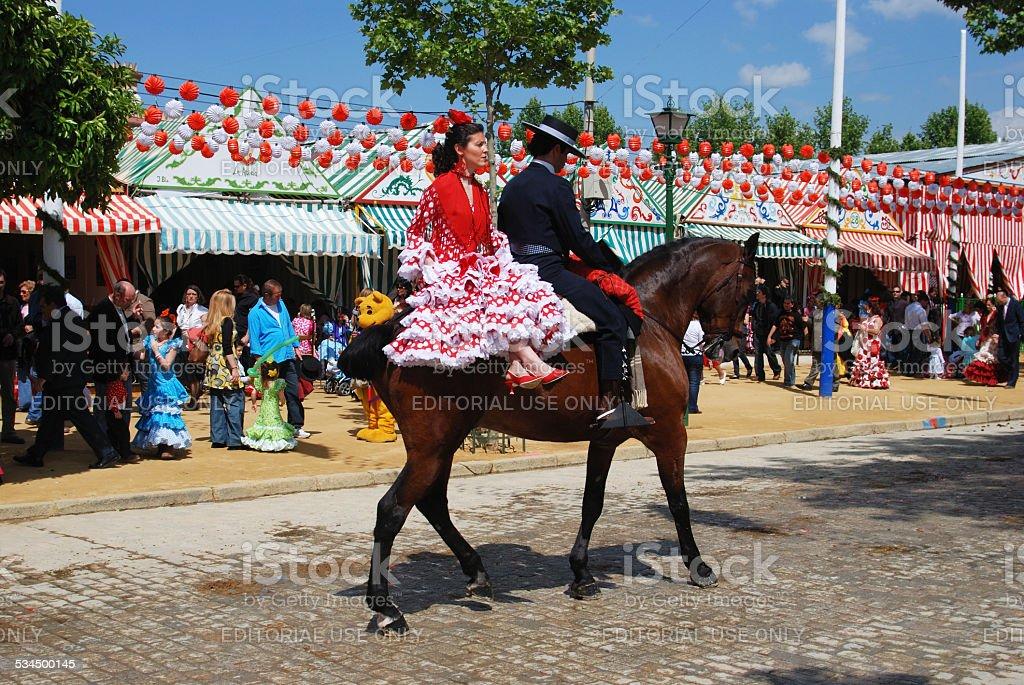 Couple on a horse at the Seville Fair, Spain. stock photo