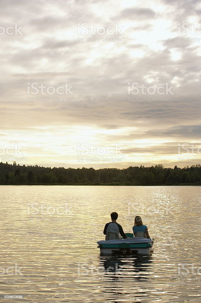 Couple on a lake stock photo