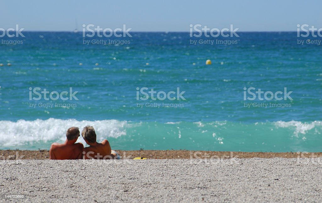 Couple on a lonely beach royalty-free stock photo