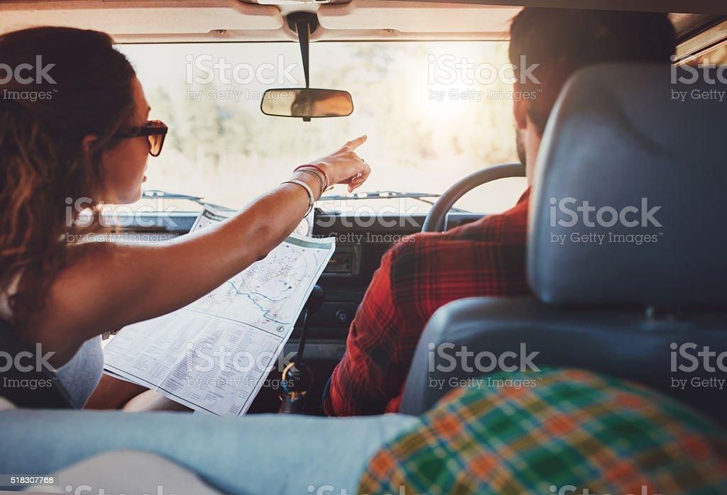 Couple on a road trip taking detour stock photo