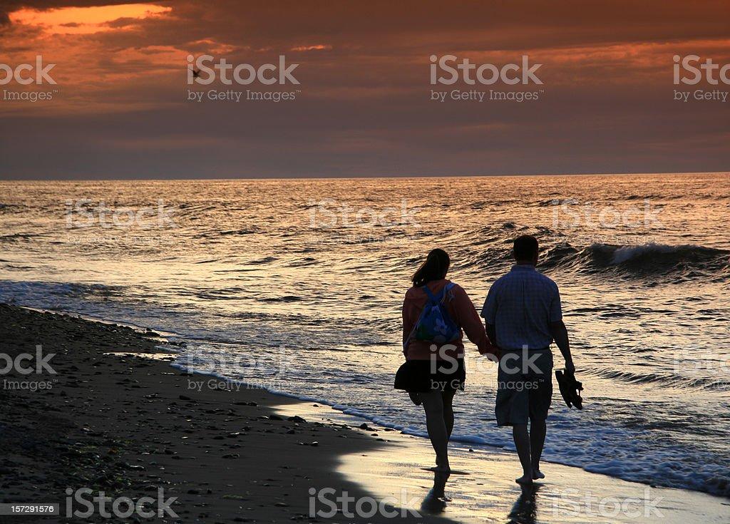 Couple on a Romantic Beach Walk royalty-free stock photo