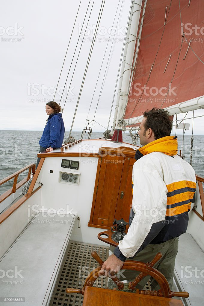 Couple on a sailboat stock photo