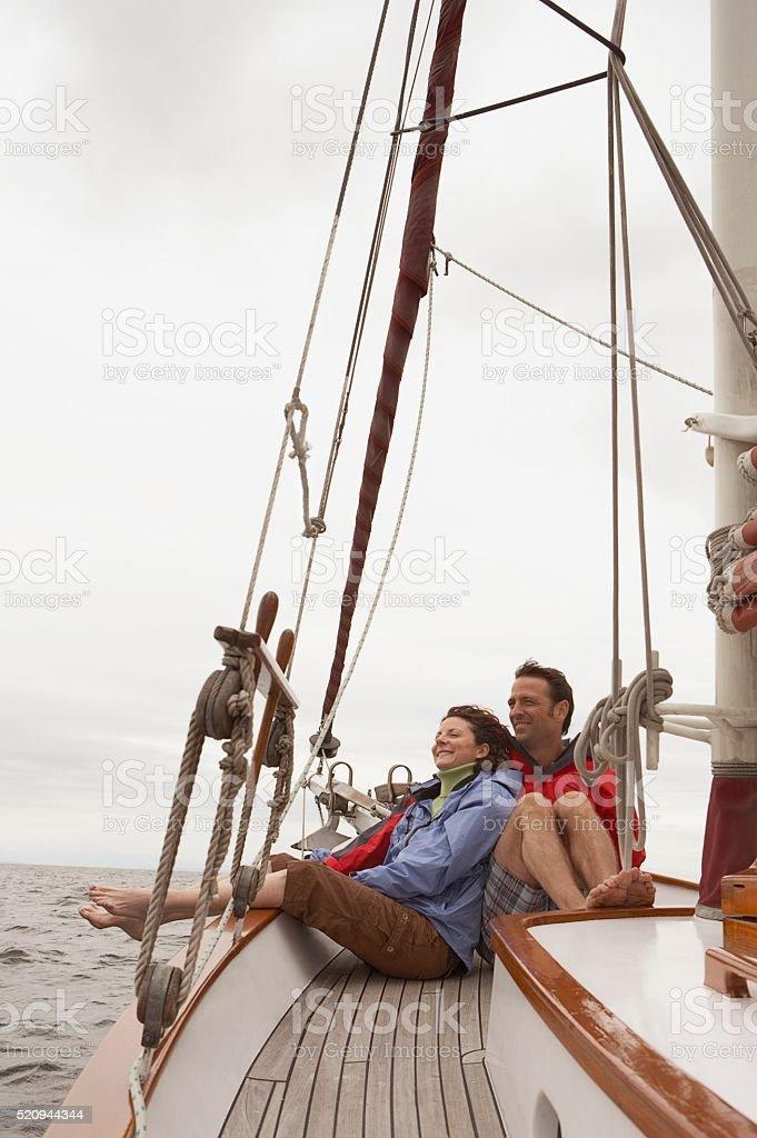 Couple on a sailboat stock photo