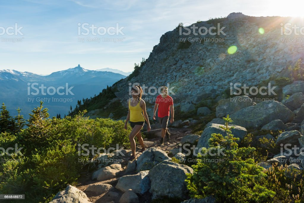 Couple on a stunning hike in the mountains stock photo