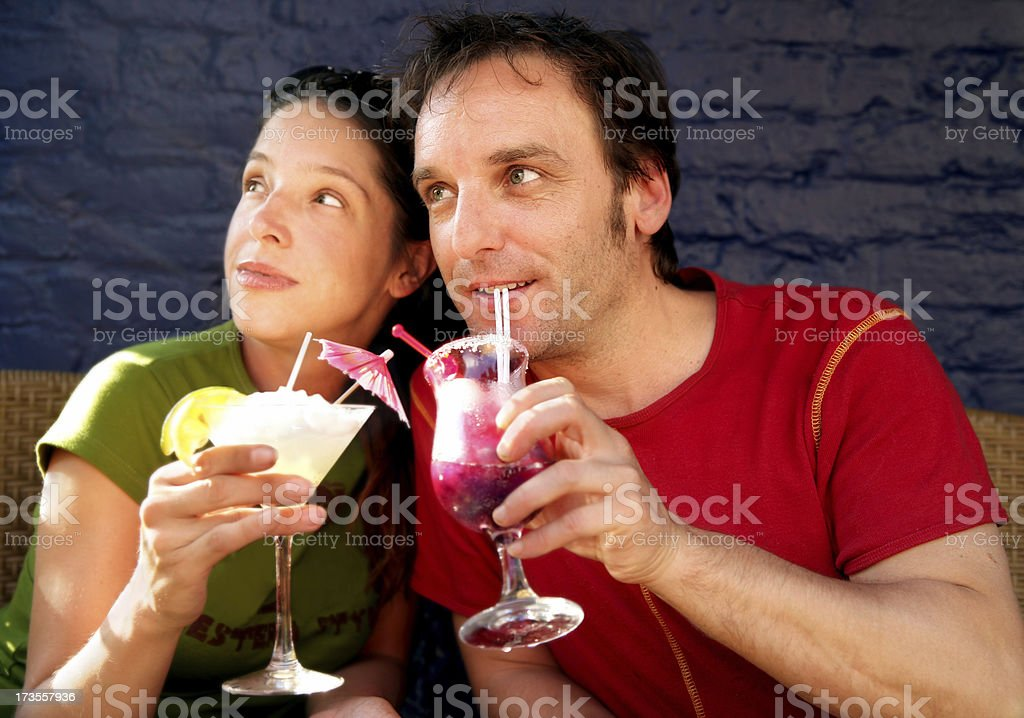 Couple on a terasse looking sideway royalty-free stock photo